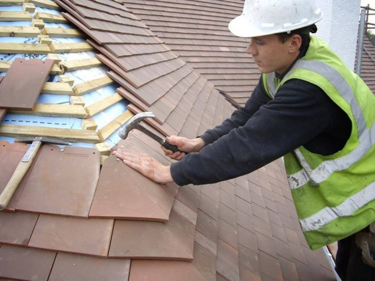 roofer in glenrothes repairing tiled roof